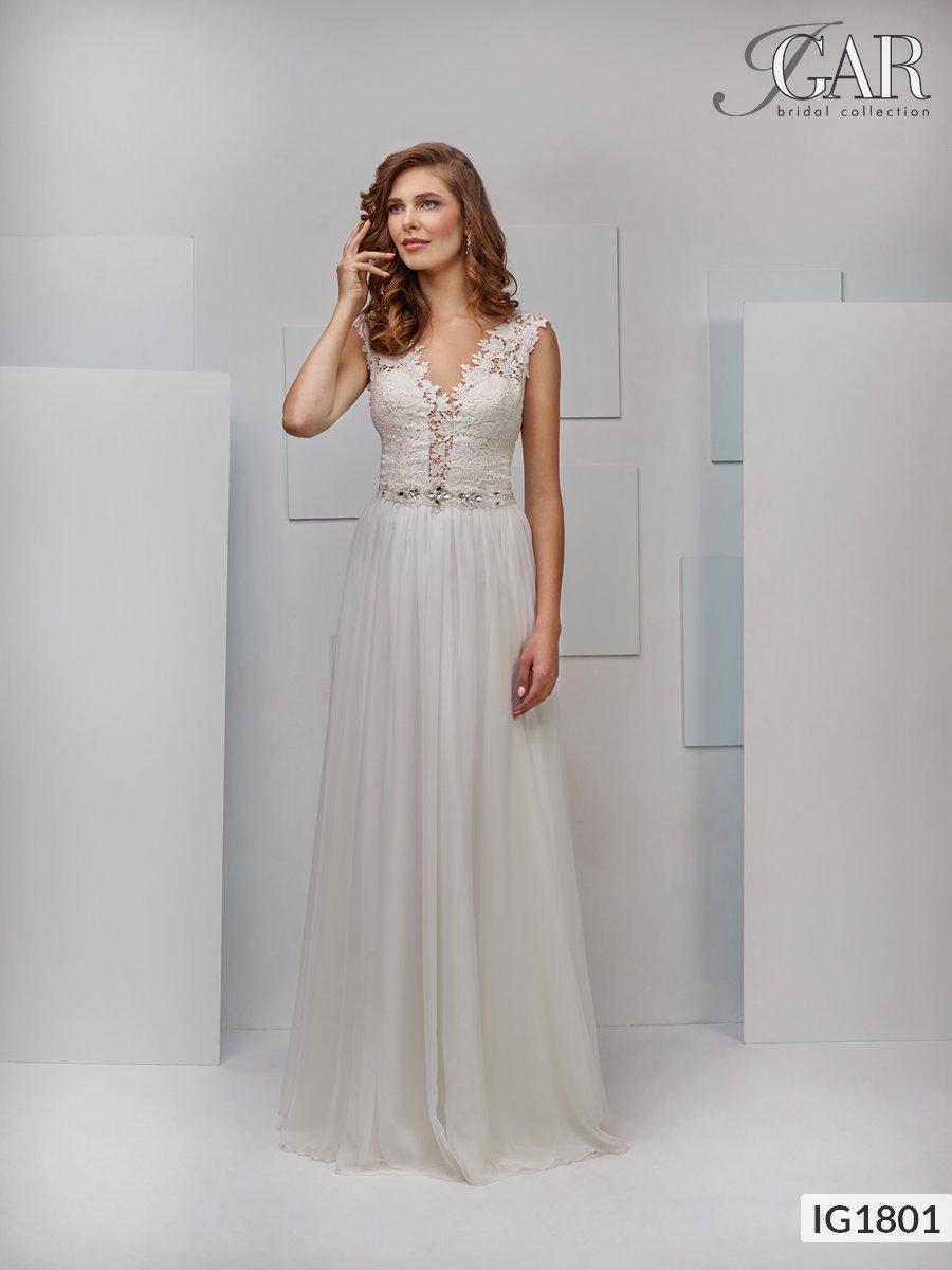 3d1120a651 Delikatna suknia ślubna z muślinu. Gorset z dekoltem w kształcie litery V z  przodu i z tyłu ozdobiony delikatną koronką. W talii srebrny